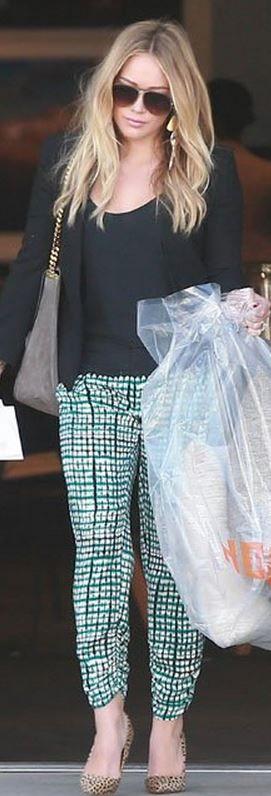 Who made  Hillary Duff's green print pants, sunglasses, jewelry, pumps, and handbag?