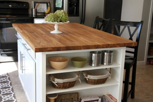 builder-grade kitchen island expansion with butcher block top and added display shelf