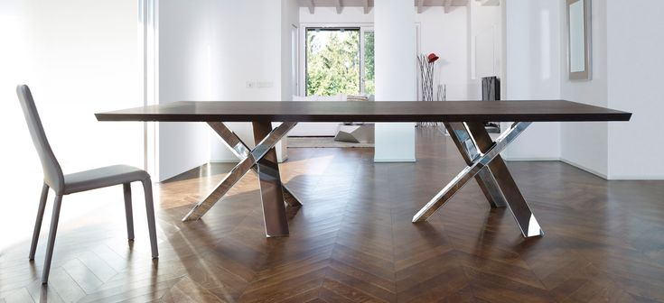 ANTONELLO ITALIA – TWINS RESORT Comprised of two tri-part bases consisting of pieces that delicately balance and reinforce each other while supporting a beautiful wood surface, the table's design successfully integrates art with the utility of a dining table.  #ItalianDesignerFurniture #LuxuryDiningRooms