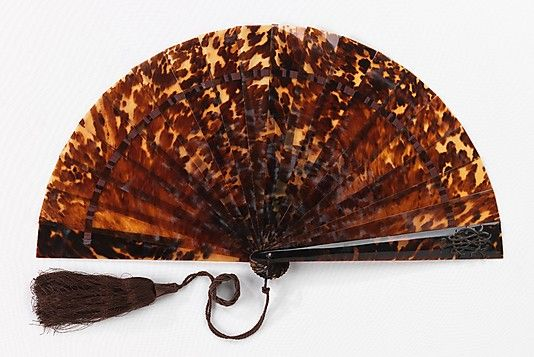 Fan (Brisé)  Date: 1875–89 Culture: French (probably) Medium: tortoiseshell, silk, synthetic Dimensions: 10 1/4 in. (26 cm) Credit Line: Brooklyn Museum Costume Collection at The Metropolitan Museum of Art,