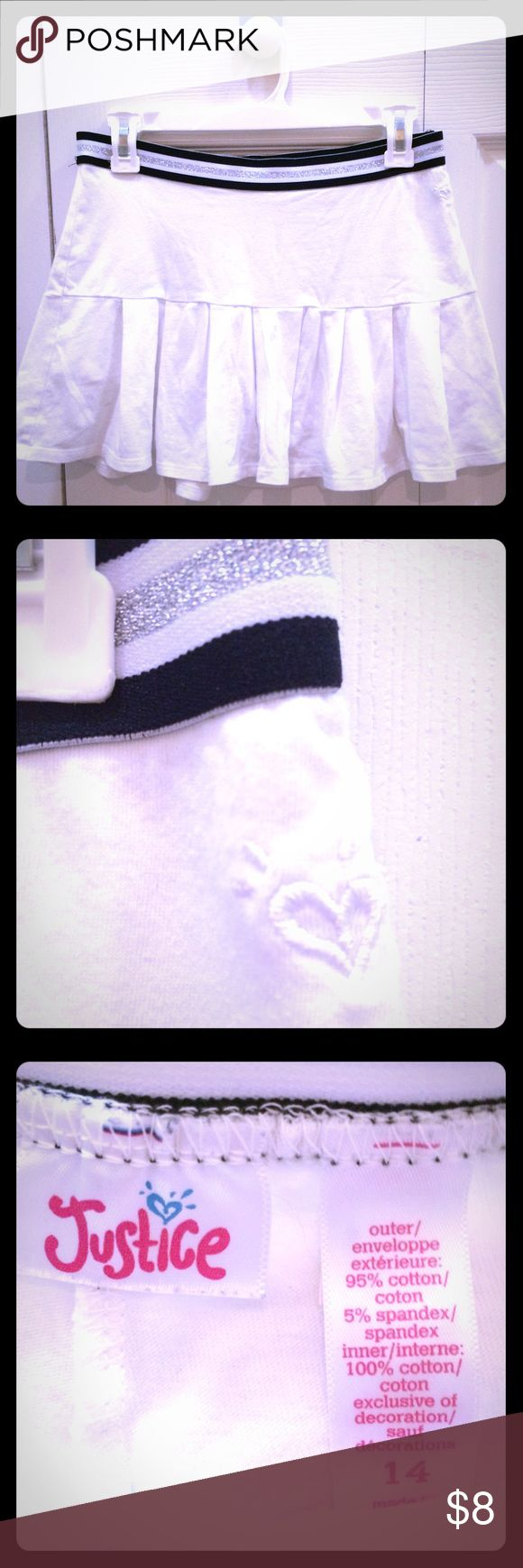 Justice white mini skirt Justice white mini skirt, has shorts build in, size 14, great condition Justice Skirts Mini