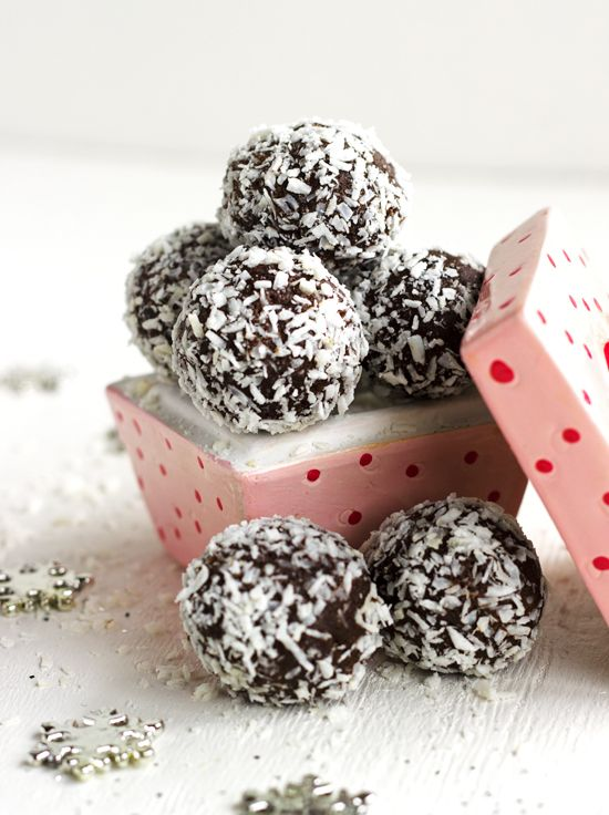Almond Joy Truffles - These are SO creamy, you would never know they are naturally sweetened, gluten free and have NO butter! | Foodfaithfitness.com | #recipe #chocolate #glutenfree