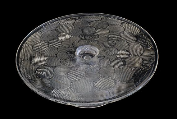 Vintage Nuutajarvi Glass Cake Tray Miranda.. Designed by Heikki Orvola in 1971-1975.. Scandinavian Design Finland It is in excellent vintage condition... Glass is a little bit yellow.. Height: 9 cm / 3.5 inch Diameter: 26 cm / 10.2 inch (Please view the photos which can be enlarged to have a really good look at the detail) Thank you for looking!! Take a look at the rest of our Etsy shop: www.etsy.com/shop/fcollectables ·················································...