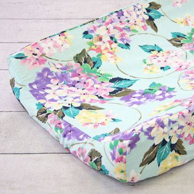 Make your changing table fun and cute with our mint and purple floral Holly's Hydrangea changing pad cover.