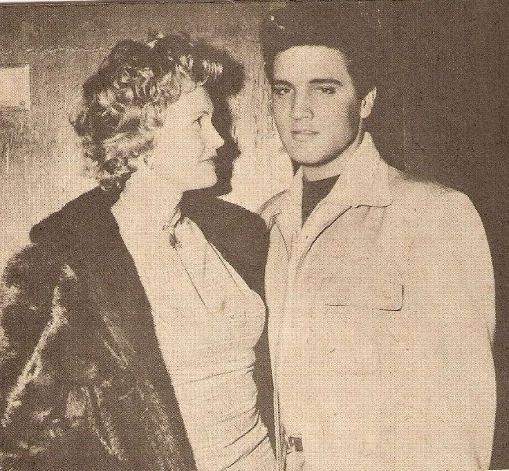 """Elvis Presley with columnist/ reporter May Mann on the set of """"King Creole"""", 1958"""