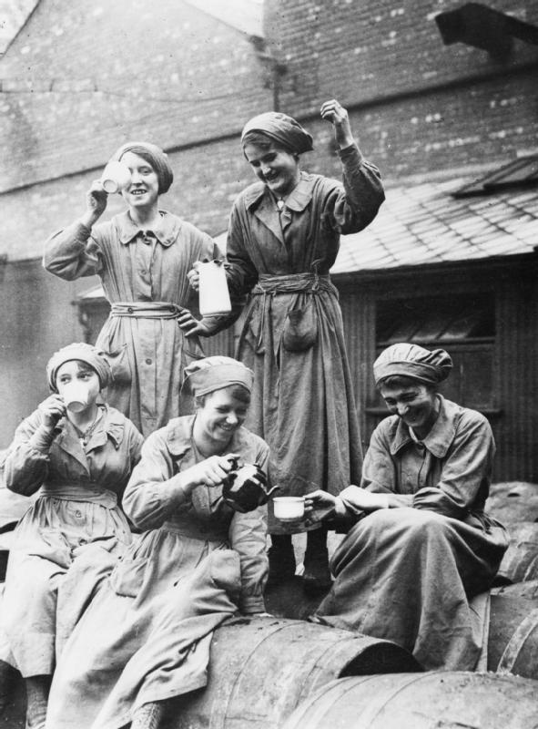 A group of women workers at the British Oil Cake Company, Manchester take a tea break. Leisure opportunities such as this for women during working hours became increasingly limited as war progressed and placed a great strain on their endurance. WWI
