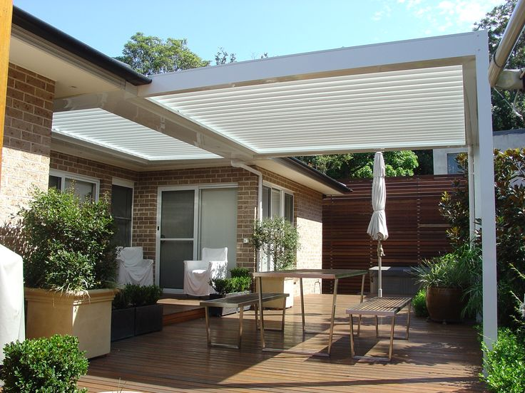 Simple yet effective multi-bank louver roof over alcove and main deck area.