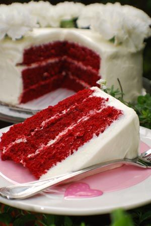 Red Velvet Cake with  Ultimate Cream Cheese Frosting     When I set out to master red velvet cake, I found many recipes just short of perfection – some were not as moist as I'd like, and others were a truly scary color. After lots of experimentation, I've arrived at my own personal favorite; moist and delicious with a rich, sophisticated hue. Don't plan on leftovers.