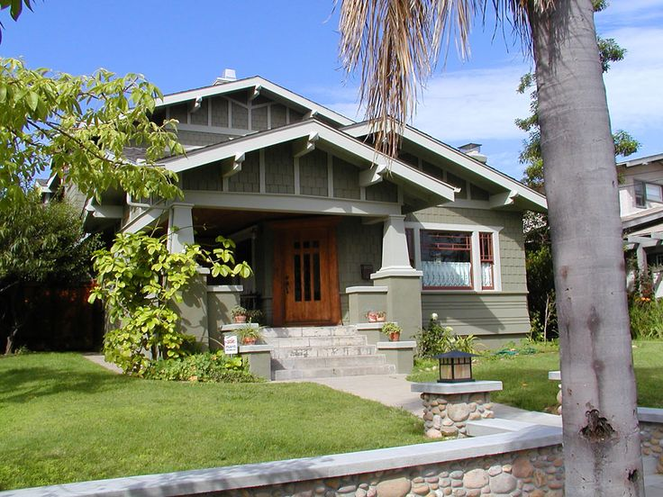California Bungalow basic form with projecting roof rafters.