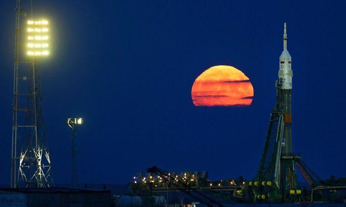 Supermoon: world's skywatchers seek clear skies for rare sight