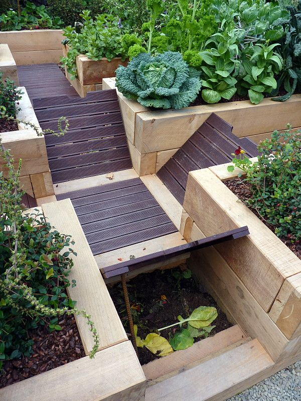 An underground composting system beneath the board walk - a great idea for small spaces & messy gardeners! Designed by HEDGE Garden Design & Nursery
