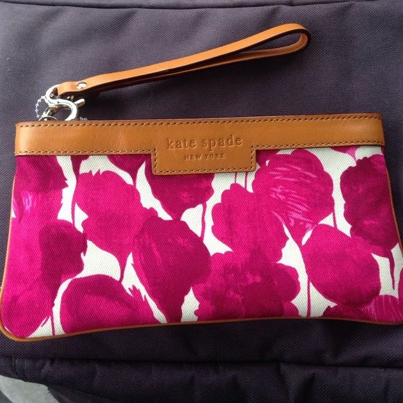 Brand-new Katie Spade wristlet/purse authentic This Kate spade pink purse is brand-new but without tags.it is in mint condition . Authentic number inside purse Q064 WLRUO287. This is a beauty with leather around the top of it. kate spade Bags Clutches & Wristlets