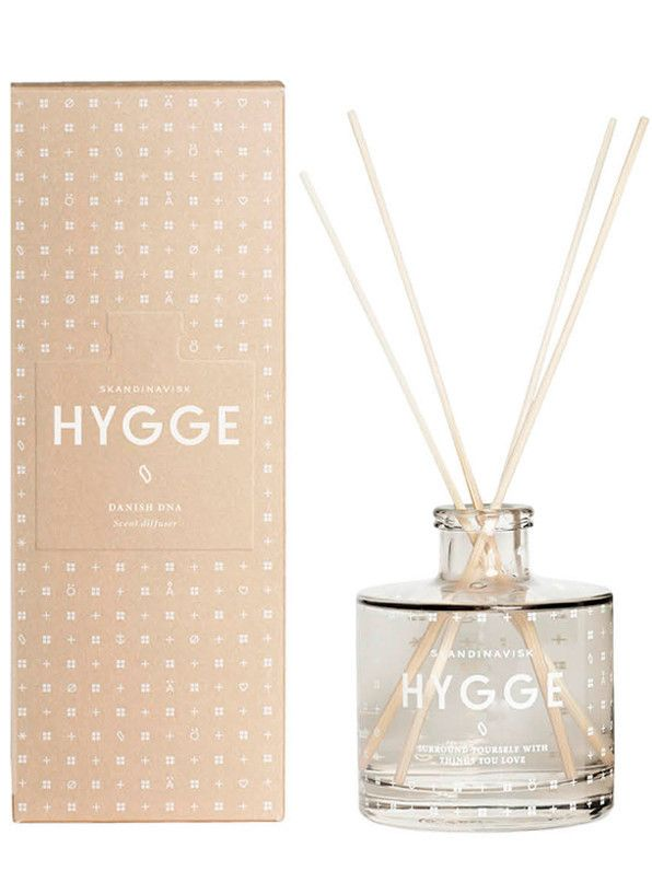 Skandinavisk Hygge Scent Diffuser: Hygge[HU-GAH]. Hygge is Danish DNA, a reflection of the Scandinavian art of creating intimacy,  fellowship and cosiness in the smallest everyday moments. With echoes of brewed tea and baked strawberry cake, rose petals and wild mint.Will scent a room for at least 3 months. To get the most from your scent diffuser remove the seal, place the sticks into the liquid – the more sticks used the stronger the scent - then rotate the sticks weekly, using a paper…