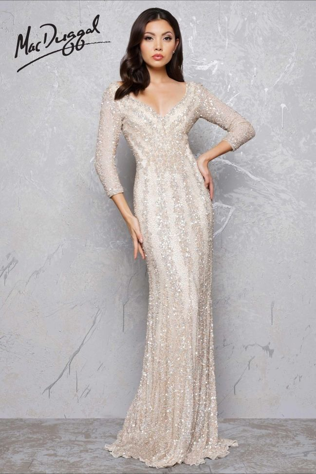 Dazzle Boutique is a full service special occasion dress shop for pageants, proms and dazzling Moms! Click to see other gorgeous gowns like this long-sleeved beaded gold gown by MacDuggal