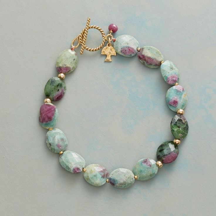 """FORTUITY BRACELET -- A bracelet to showcase for the distinctive look of ruby-in-fuchsite, with golden beads between faceted ovals of the unusual gemstone. Handcrafted exclusive with 14kt gold filled toggle clasp. 7-1/4""""L."""