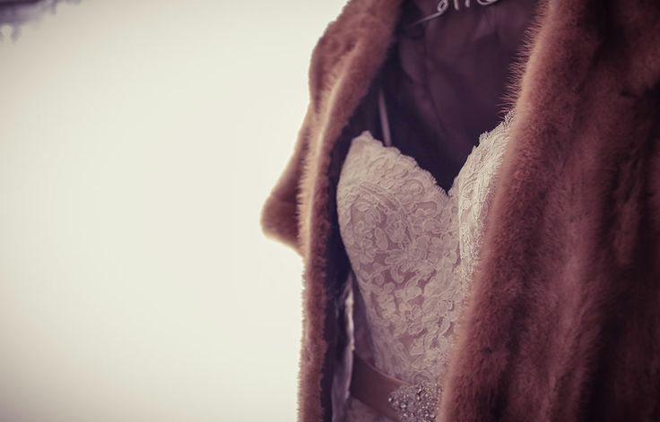 Fur vest with wedding dress for winter wedding by New Vintage Media