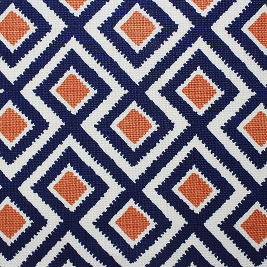 Alannah Bespoke Linen Fabric A 100% cotton upholstery fabric with a classic diamond trellis designed by Bernard Thorp, printed in navy blue and orange on a white background.