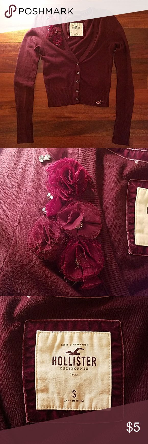 HOLLISTER Maroon Cardigan rhinestones flowers HOLLISTER Classic maroon cardigan with chiffon flowers and rhinestones. Perfect with a white tank and jeans or a nice dress. In good condition. Hollister Sweaters Cardigans