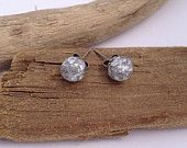 Super sparkly silver leaf flake faceted eco-resin spheres on allergy-friendly studs.