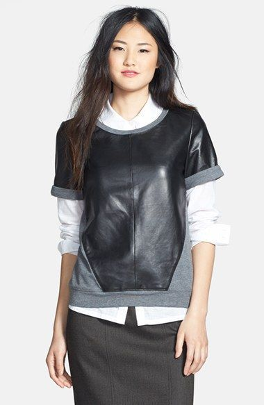 Faux leather mixed with a three-quarter sleeve heather-grey sweatshirt for the ultimate in urban yet comfy fashions.