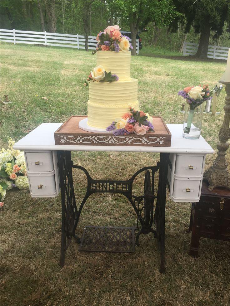 outdoor wedding vintage sewing machine stand blondies