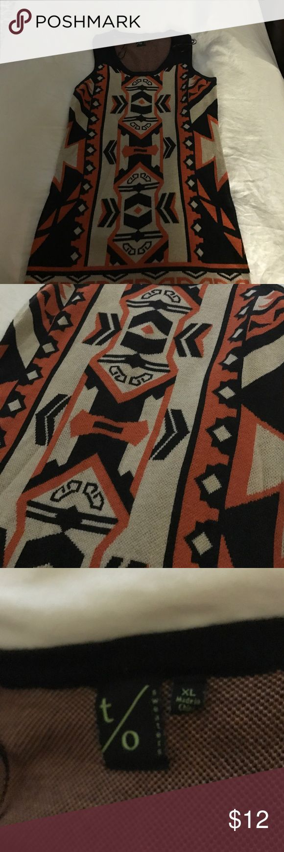 Orange and black tribal sweater dress Very cute orange and black tribal sweater dress. Perfect statement piece. Looks great with leggings. Can be worn dressed up in the office or dressed down for a night out. Dresses