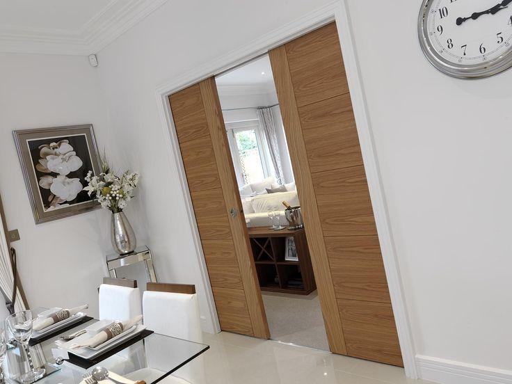Oak veneered pocket sliding doors. JB Kind's River Oak Modern - Tigris #oakdoors #pocketdoors