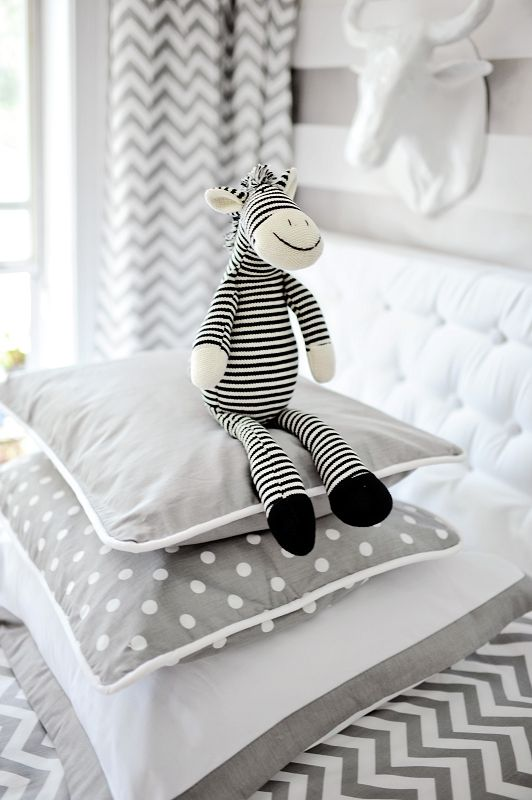 We love mixing and matching different patterns to create a modern and fun space. This gray throw pillow is from our Zig Zag Baby Bedding Collection!