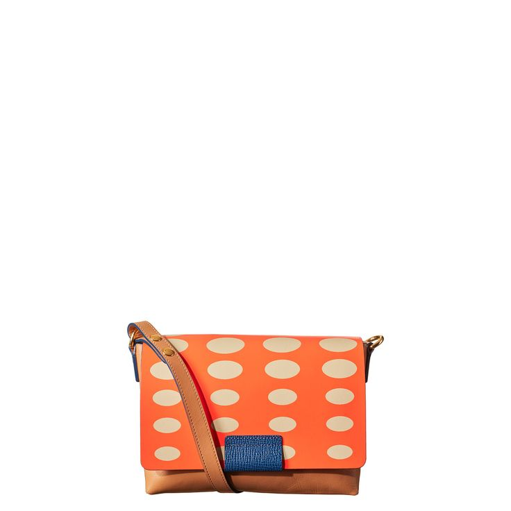 Orla Kiely Oval Printed Robin Bag: Leather Oval print soft structured handbag with magnetic closure. Adjustable strap. Inside details include contrast coloured slip pocket and elastic key chain. The leather is hand screen printed so please allow for small variations in the print. Natural marks and creases developed over time are seen as a natural part of leather bag use and cannot be regarded as a fault.
