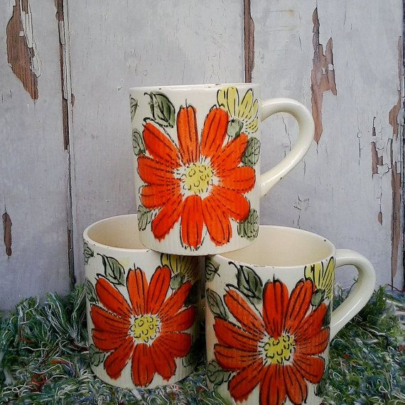 Check out this item in my Etsy shop https://www.etsy.com/listing/209648248/kitsch-bright-orange-coffee-cups-on-sale