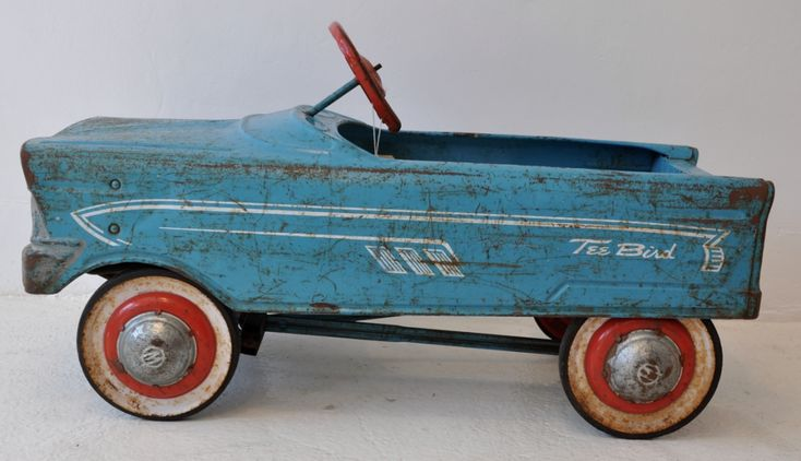 """A vintage (1950s) Murray """"Tee Bird"""" steel pedal car. Neighbor children had a car like this I remember riding. The all-original one shown here is worn, but that makes sense: pedal cars were sturdy and well-loved, so they got passed down and played with by many children. Once you were too big to drive, smaller children welcomed their turn."""