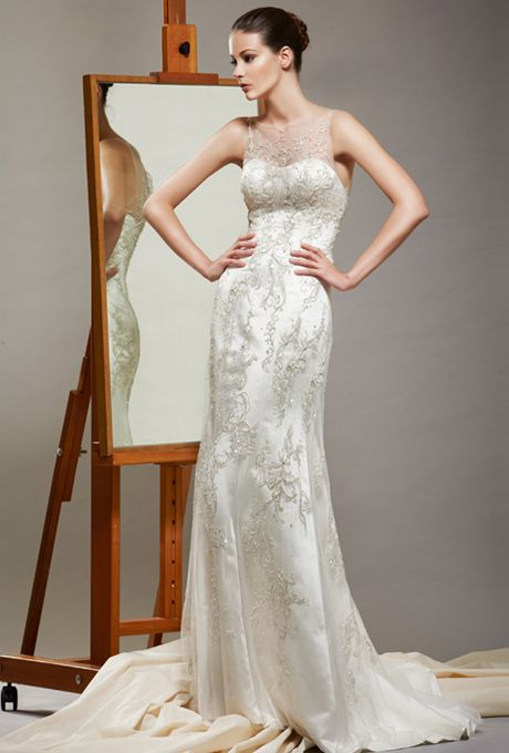 Sheer bateau neckline sheath gown beaded and embroidered with Swarovski crystals and stones through out the gown by Saison Blanche Couture