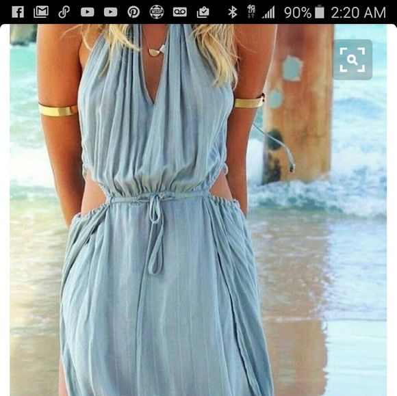 Sexy flow with the wind dress.  BeachSummer Ready Sky Blue jumper with skits in all the right places.  Sexy outfit or cover up for the confident as it flows with the wind.  Your extra cover up over wet or dry swinsuit.  This flow with the wind dress has never been worn. Dresses Maxi