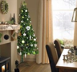 The Half Christmas Tree. I'm actually considering this, the rooms in our new house are too small for a big tree!