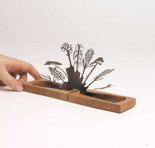 Lizzie Thomas- Hidden winter inspired by experiencing how the Japanese celebrate the seasons, the 'Hidden Season' series are wooden books holding hand cut paper pop up scenes inside. Having caught the transient, each season is waiting to burst out at any time of the year.