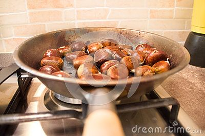 Roasted chestnuts cooking on a pan