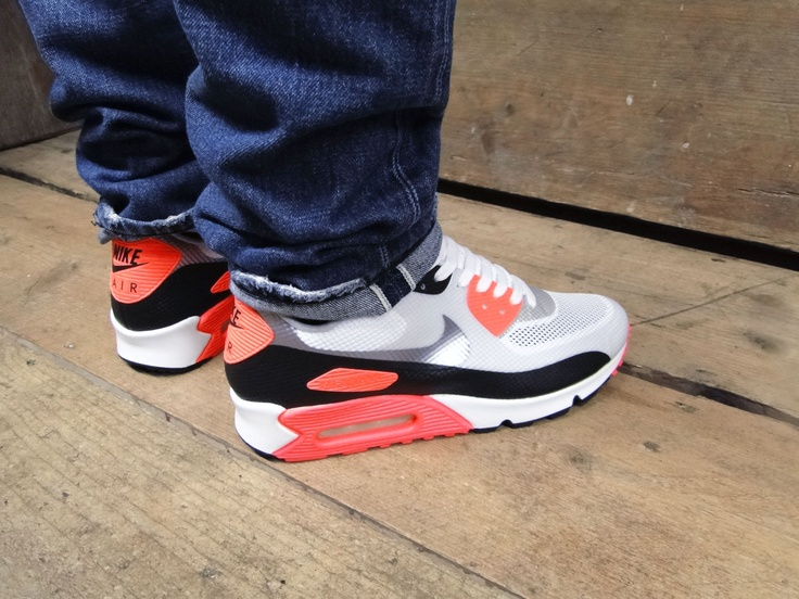 Nike Air Max worn with rolled up jeans.