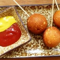 This recipe is forCorn Dog Pops Recipe using a Cake Pop Maker, not making corn dogs, but what a great idea for making hush puppies!