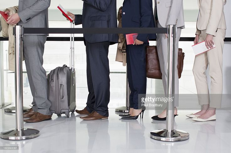 Stock Photo : Business people standing in queue at airport
