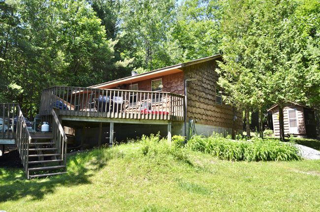 Parry Sound Area:  Grand view of  Lake. That`s what you see from this cottage that's just 10 min from Parry Sound. Gentle sloping to a welcoming waterfront. Large white pines adorn the shoreline for that Northern look. Cottage shows very well with a touch of antiquity. Large deck across the front. Sleeping cabin will sleep four.329.14A $349,900 GREEN & GOLD GOT IT SOLD!