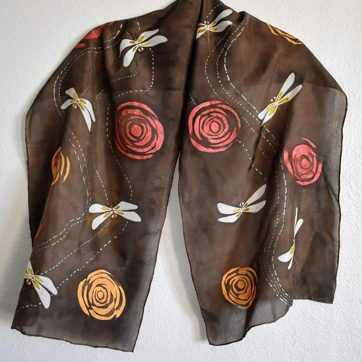 Silk scarves are up for the holiday season!  Consider Raebird Creations when looking for unique gifts for friends and family. Got some new inventory represented here, too. Like these dragonflies zipping above a stream of gold and burgundy eddies.  http://www.raebirdcreations.com/store/c2/SIlk_Scarves.html