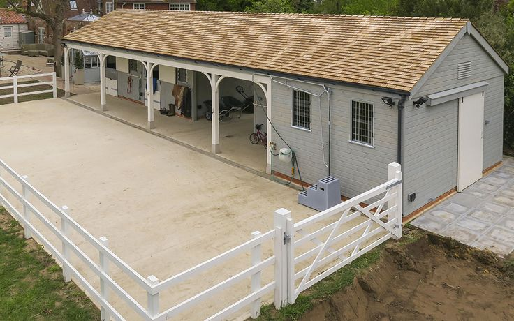 Stables designed to fit in with the colour scheme of the adjacent property.
