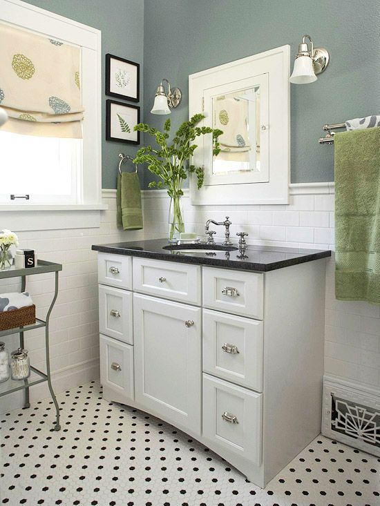 white vanity with black top, subway tile