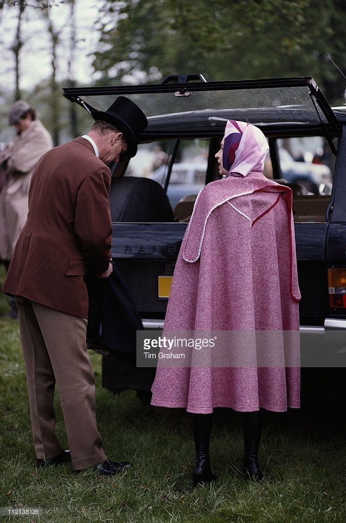 Prince Philip And Queen Elizabeth II Wearing A Pink Cape At The Royal Windsor