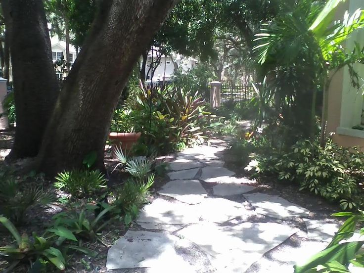 Using Flagstone In A Shady Garden In Areas Where Sod Will Not Grow