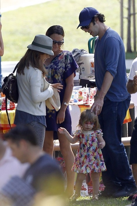 Isla Fisher and her hubby, Sacha Baron Cohen, enjoyed themselves as they took their two daughters, Olive and Elula Baron Cohen, to a park for a birthday party in Santa Monica, California on October 7, 2012.