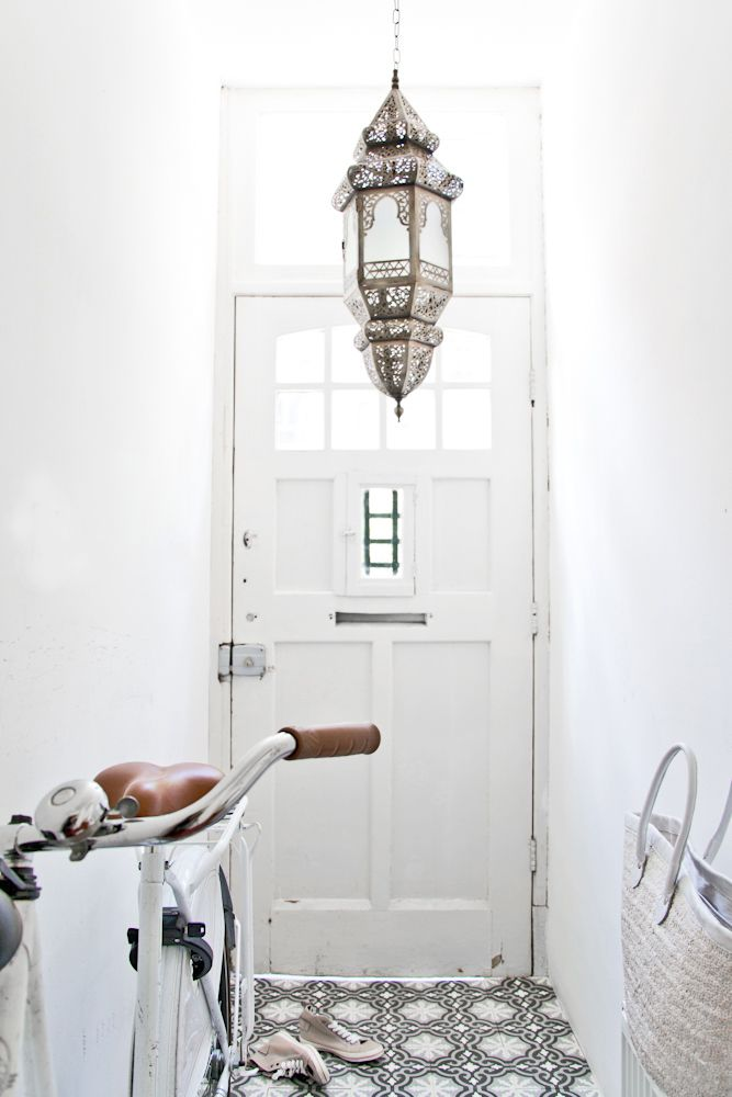 PLAIN WALLS AND PATTERNED FLOOR FOR LONG NARROW HALLWAY.  LAMP IS A LOVELY FEATURE (LOOKS A BIT LOW THO!)
