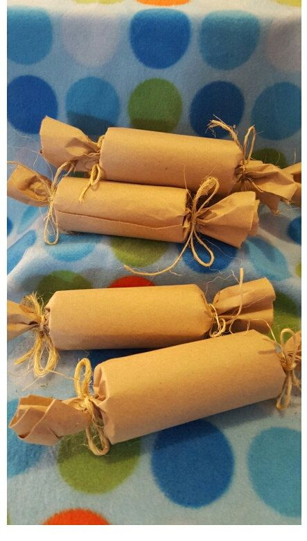 Tootsie Rolls filled with Oxbow timothy hay, sprinkled with parsley all rolled up in brown paper with sisal string. Its a toy and a snack rolled