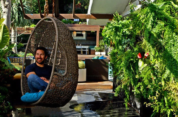 "Jamie Durie, host of ""The Outdoor Room,"" has become an HGTV star racing against the clock to turn dreary backyards into dreamy retreats in just 48 hours. When the Australian designer moved to Los Angeles, he set out to make over his own backyard, creating not just one new outdoor room but six – seven if you count the redesigned pool – all in just three weeks. Durie hangs out in one of two egg-shaped wicker nests set by walls planted with tropicals, ferns & orchids."
