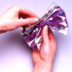A plastic bow with a pocket to display small objects is fun and unique. Learn how to create this hair bow and make an intricate herringbone braid.